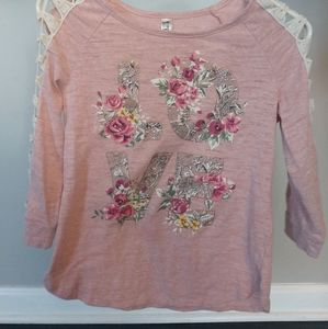 """Light pink """"LOVE"""" shirt with flower accents"""